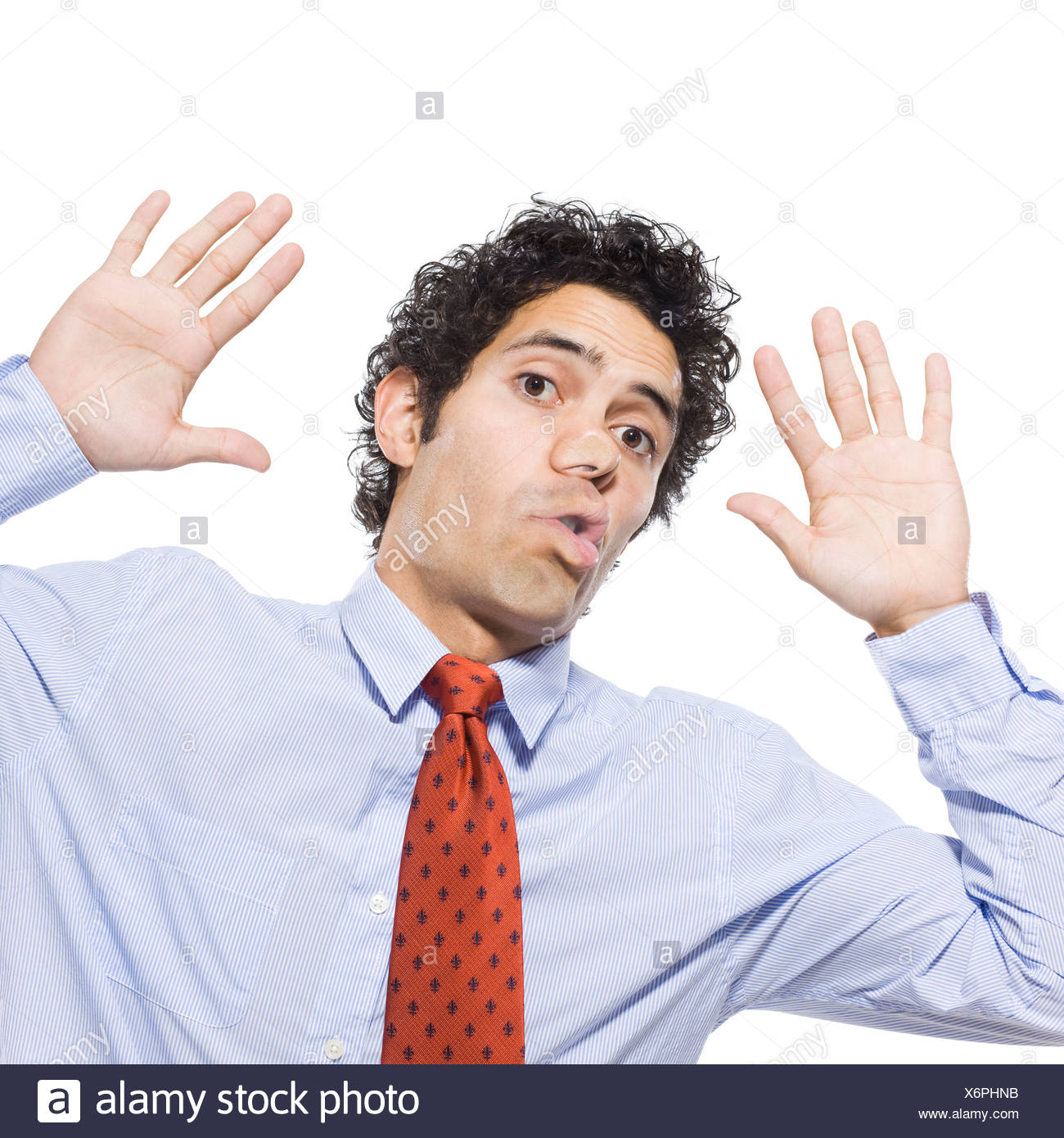 Man with face pressed up against window, studio shot - Stock Image