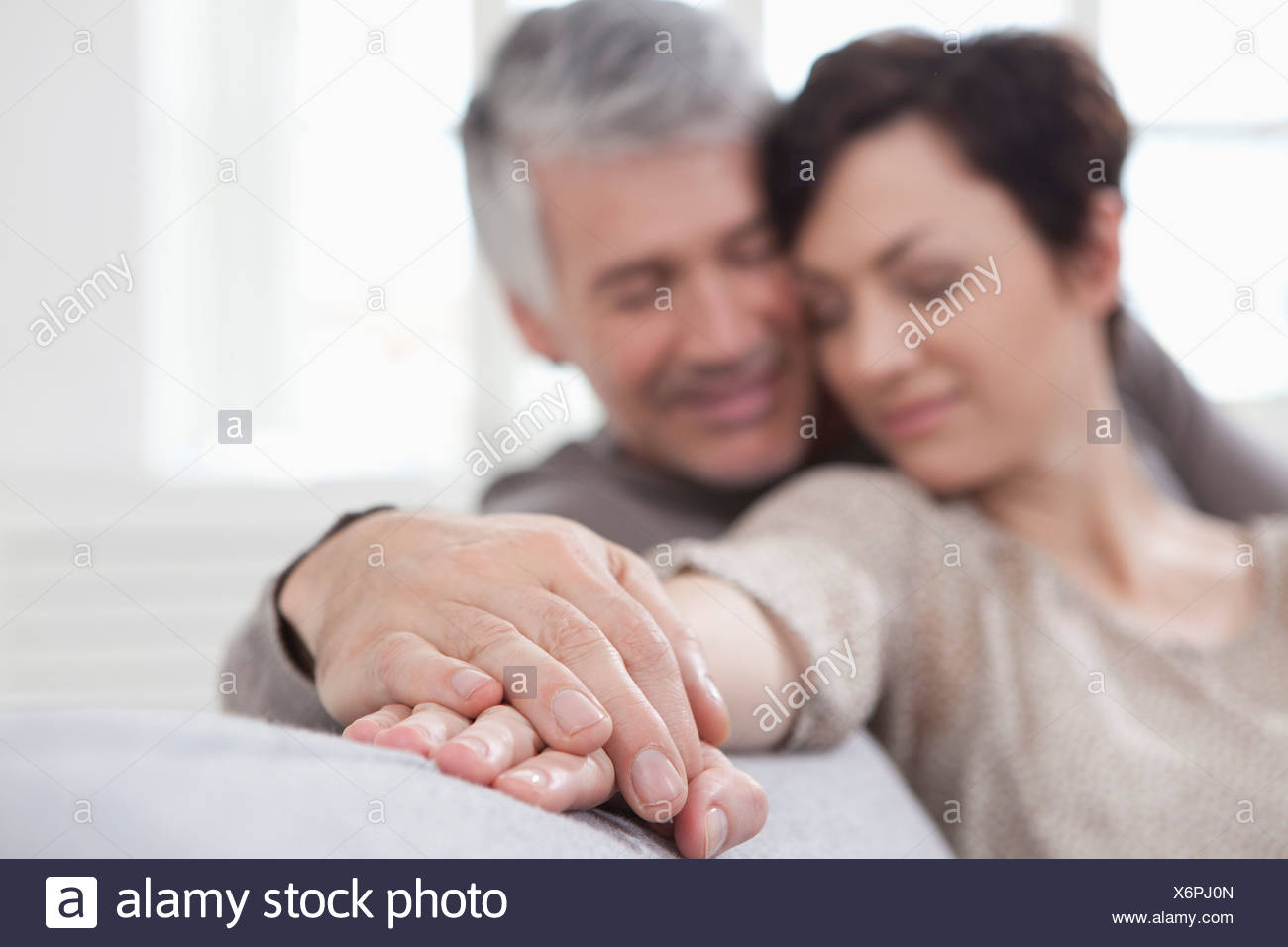 Germany, Bavaria, Munich, Couple falling in love, smiling - Stock Image