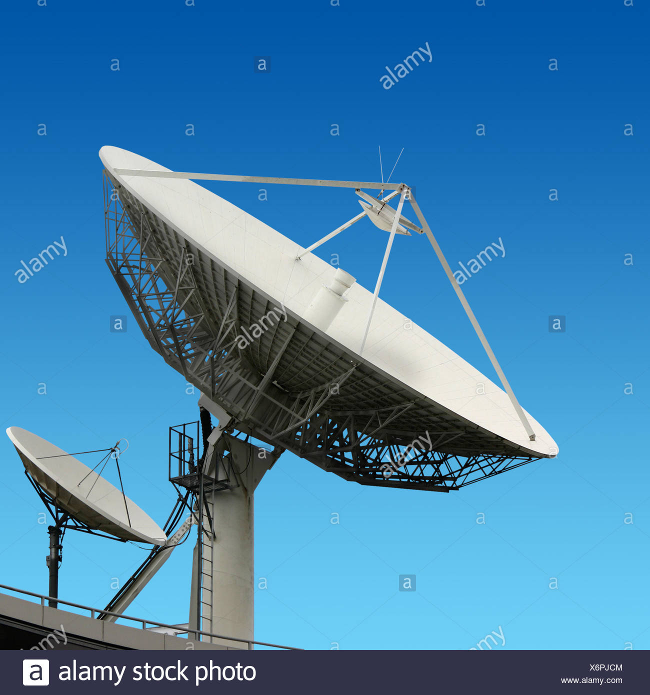 satellite dish aerial antenna clouds dish rooftop satellite sky big radio electronics  Stock Photo