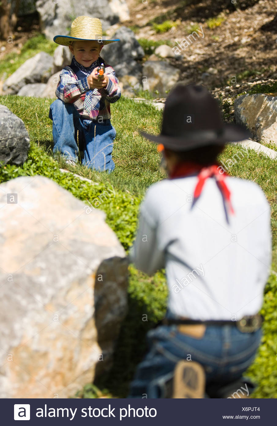 Boys playing outside - Stock Image