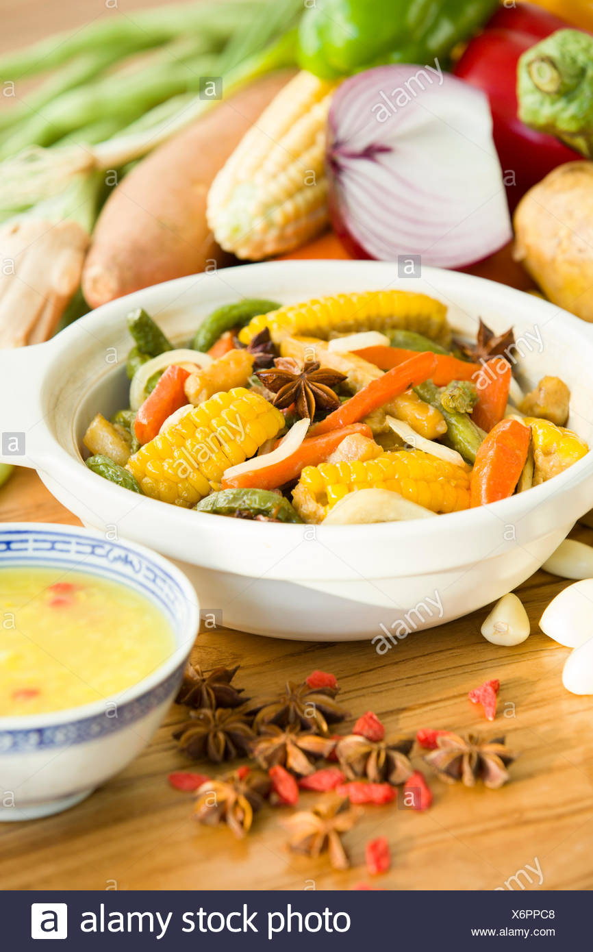 Assorted vegetables and cooked vegetable dish - Stock Image