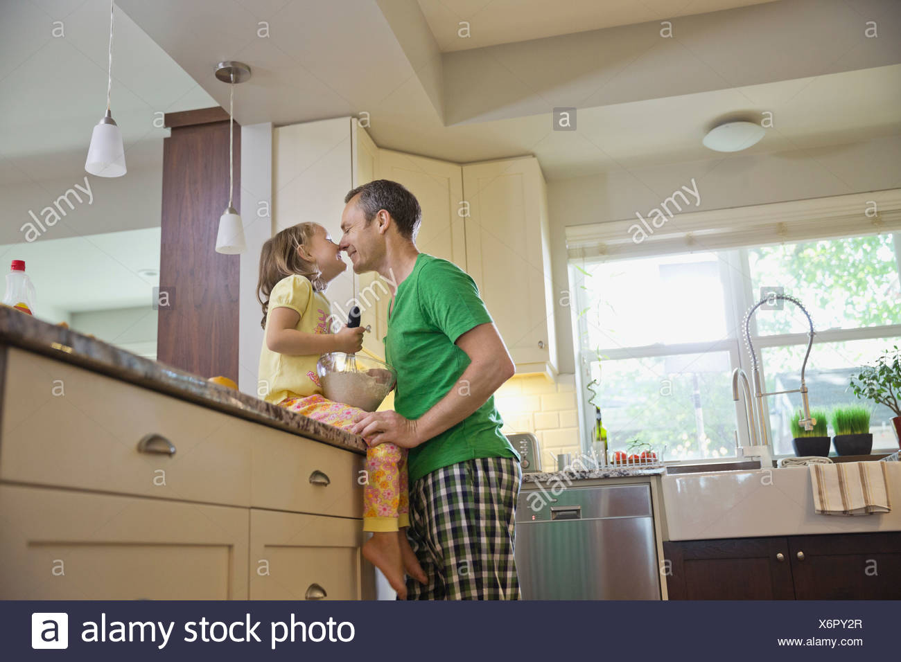 Father and daughter touching noses - Stock Image