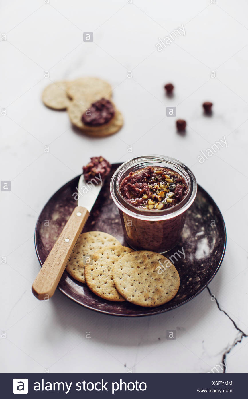 Homemade red chicory pesto in a jar. - Stock Image
