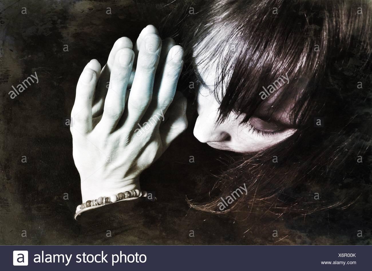 High Angle View Of Woman Praying - Stock Image