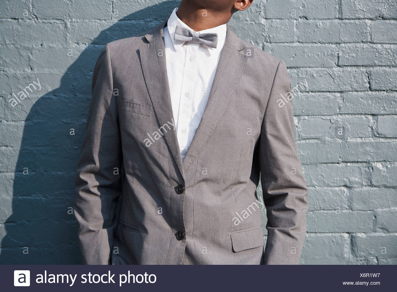 A man wearing a bow tie and suit, midsection - Stock Image