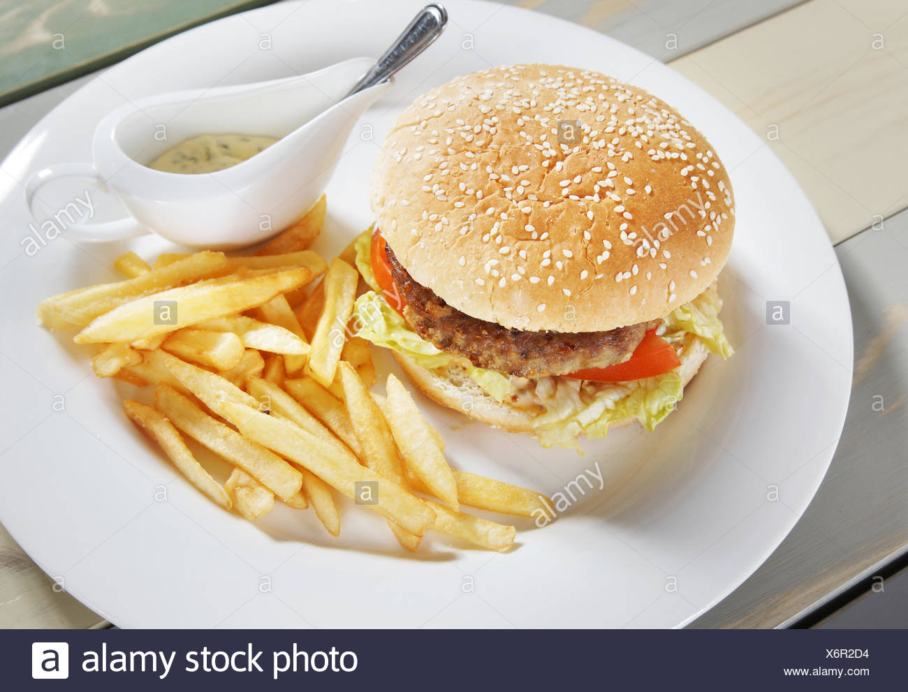Hamburger with french fries and sauce - Stock Image