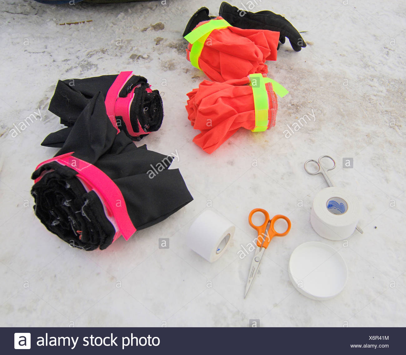 Black and orange husky booties, with tape and scissors Stock Photo