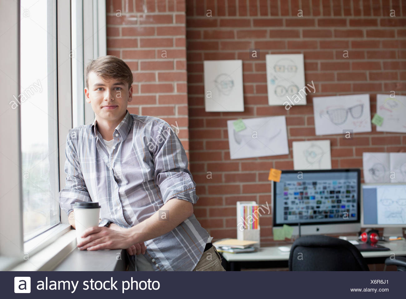 young, male industrial designer in studio - Stock Image