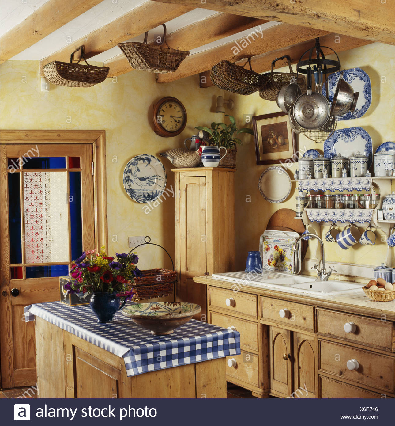 Country Cottage Beamed Kitchen with Island - Stock Image