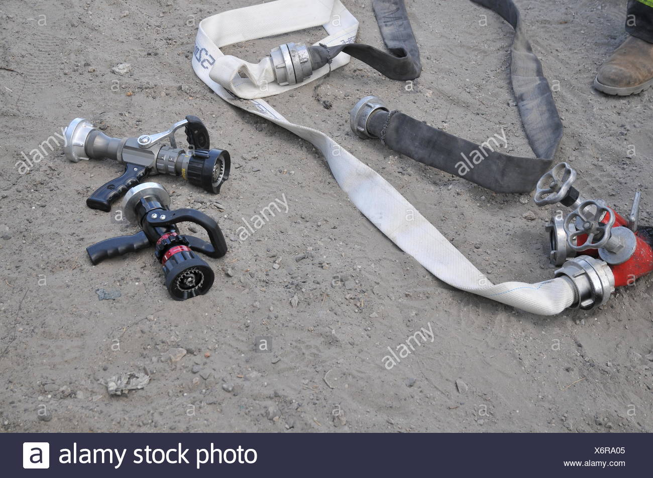 Fire fighters equipment hoses ready for use - Stock Image
