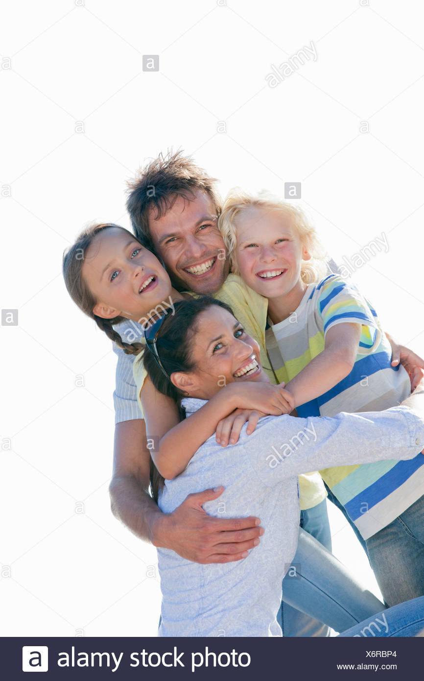 Portrait of enthusiastic family hugging Stock Photo