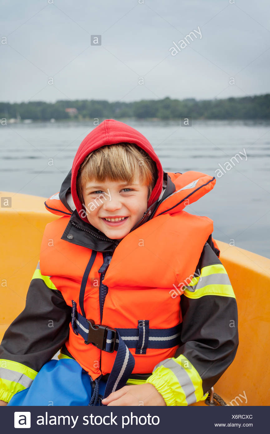 Sweden, Uppland, Runmaro, Barrskar, Portrait of boy (6-7) on boat - Stock Image