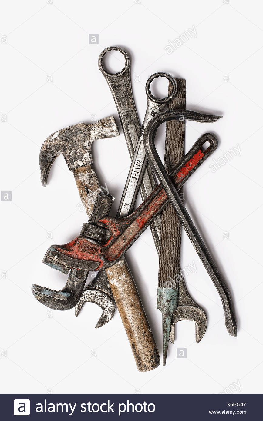 Used Tools. A group of spanners, adjustable wrench and hammer. Worn marked metal handheld tools. - Stock Image