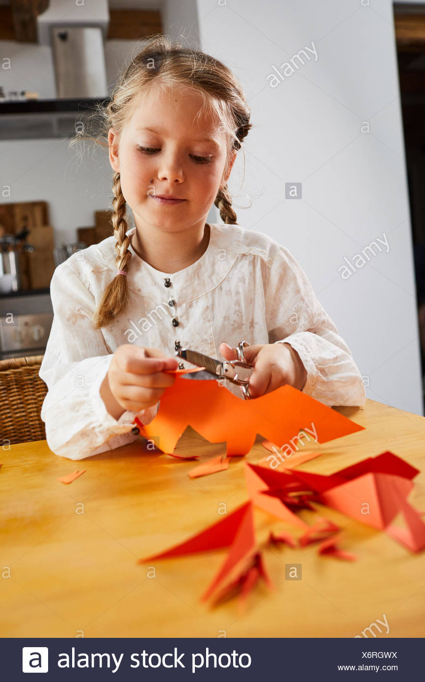 Girl cozy at home while crafting, half portrait Stock Photo