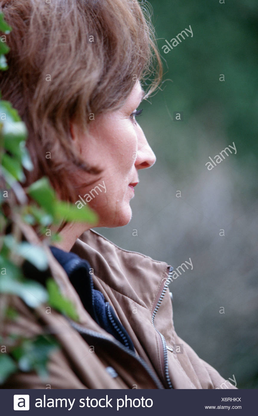 Middle aged woman in thoughts, mature woman alone sadness SerieCVS117004 - Stock Image