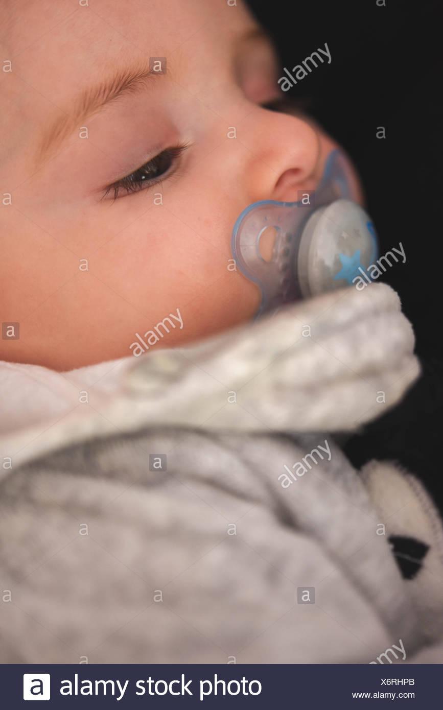 Portrait of a sleepy baby - Stock Image