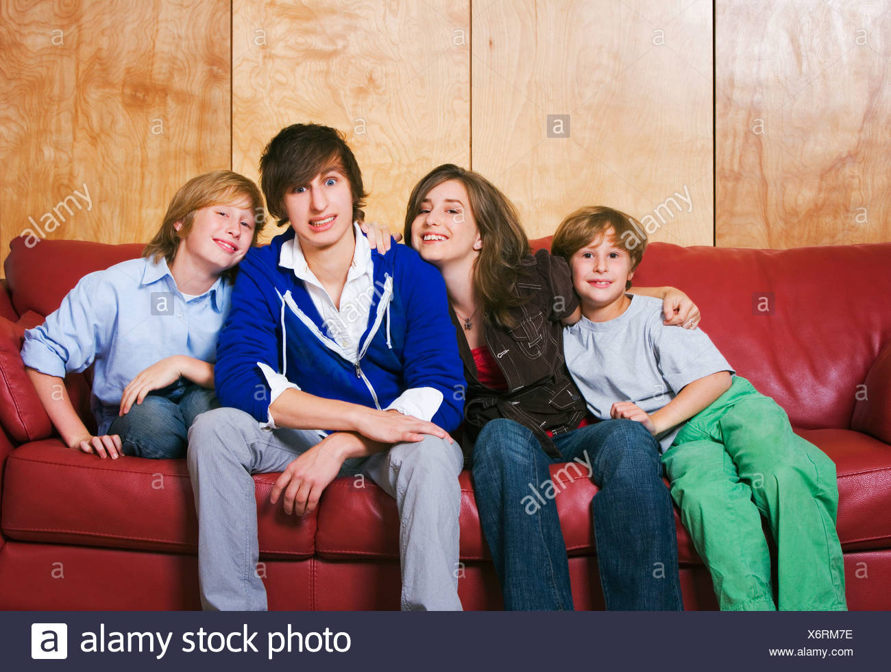 Siblings On A Couch - Stock Image