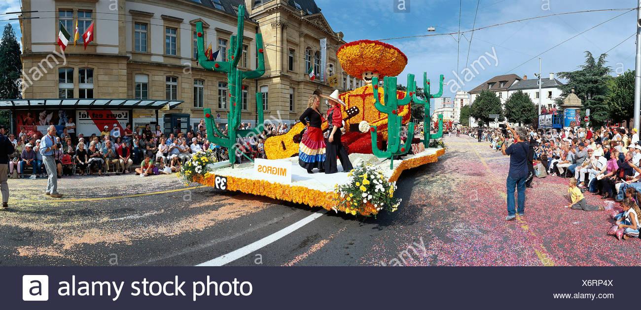 party of Vendanges vintage festival relocation move parade Switzerland Europe Neuchatel Neuenburg spectator - Stock Image