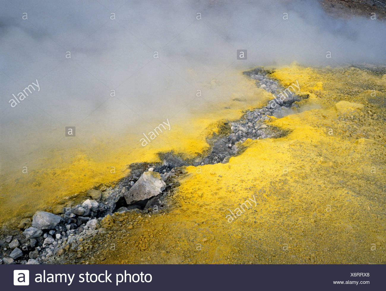 Sulphuric vapours from a crack in the earth, Vulcano, Aeolian Islands, Italy, Europe - Stock Image