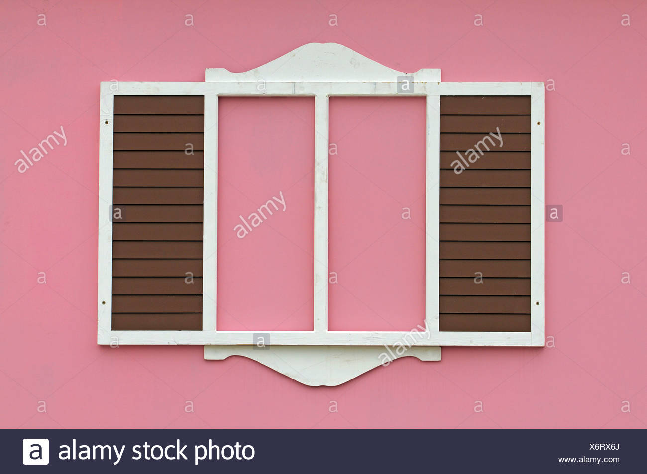 Stylised window with shutters on a pink house - Stock Image