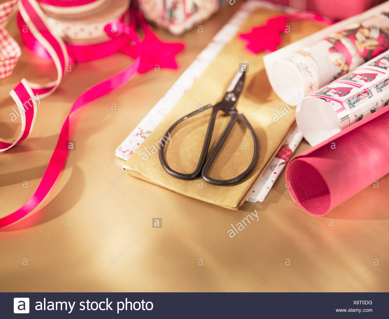 Christmas wrapping paper, ribbon and scissors - Stock Image