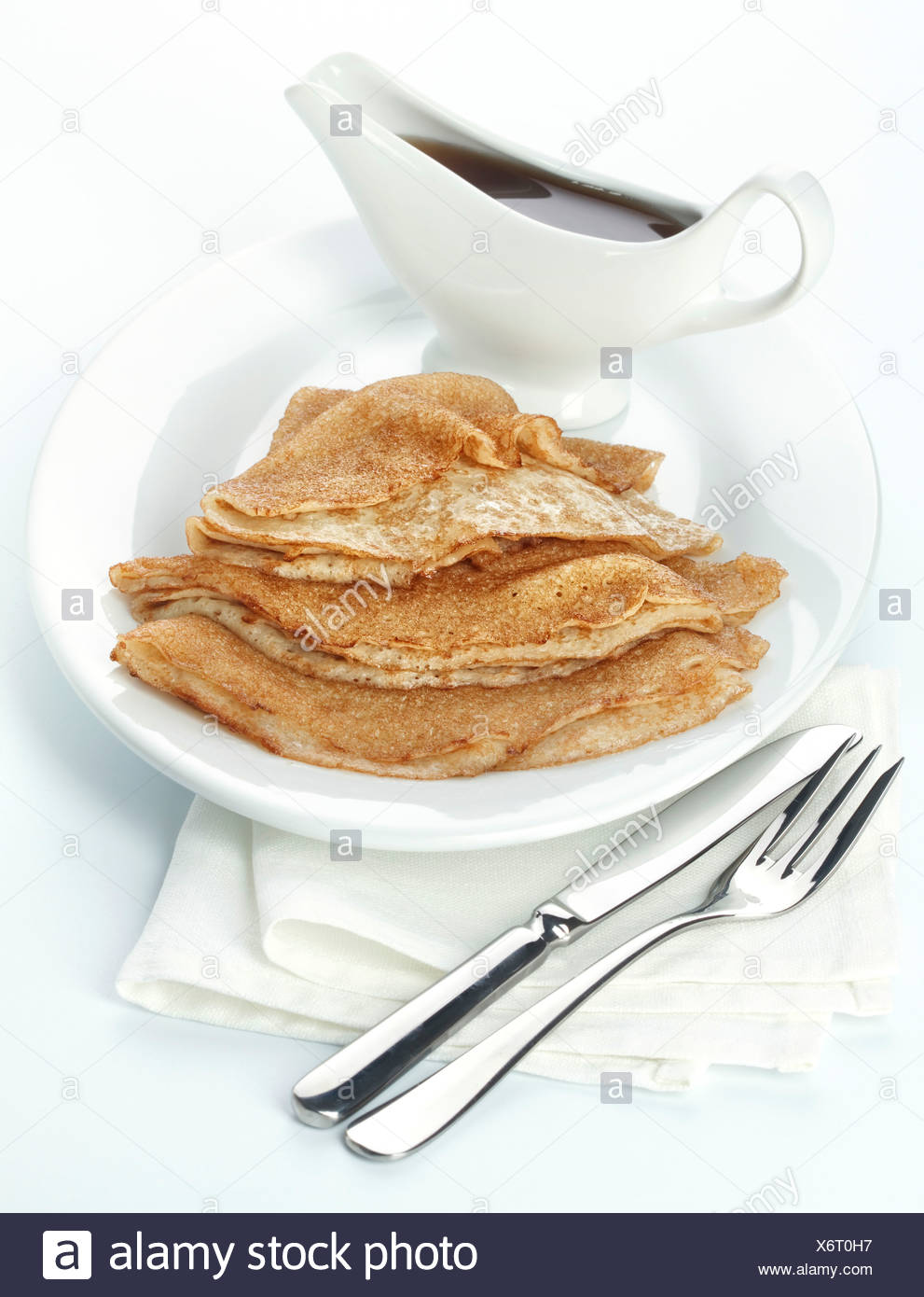 Pancakes with Maple syrup on white background - Stock Image