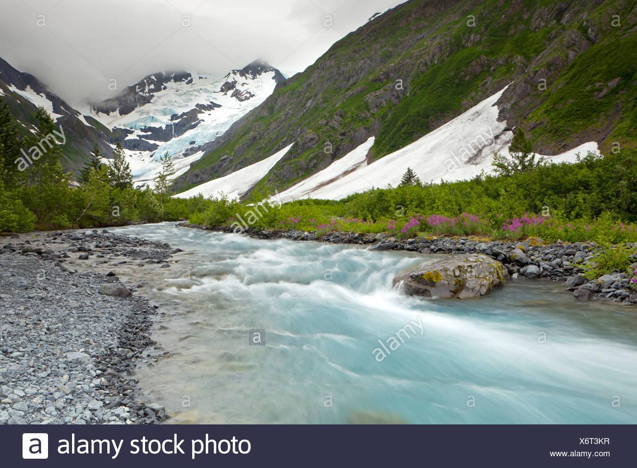 Byron Glacier and river near the Portage Glacier in the Chugach Mountains, Kenai Peninsula, Alaska, USA - Stock Image