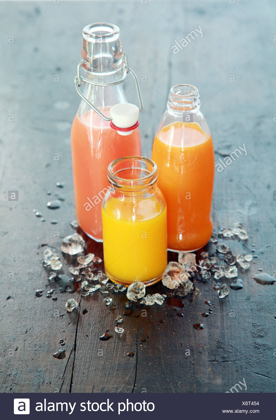 Healthy fresh home made fruit juices in glass bottles and jars