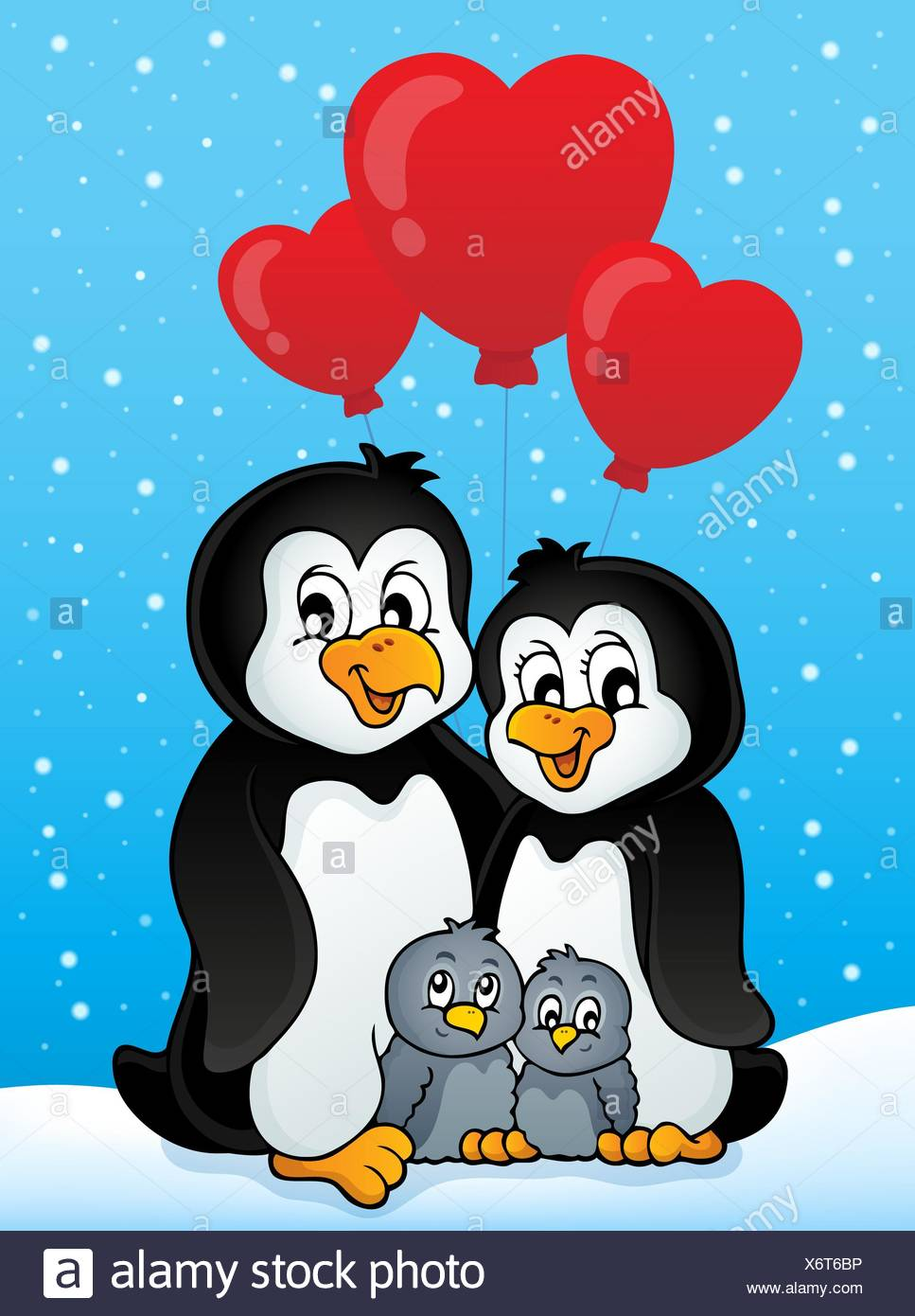 Valentine penguins in snow - Stock Image