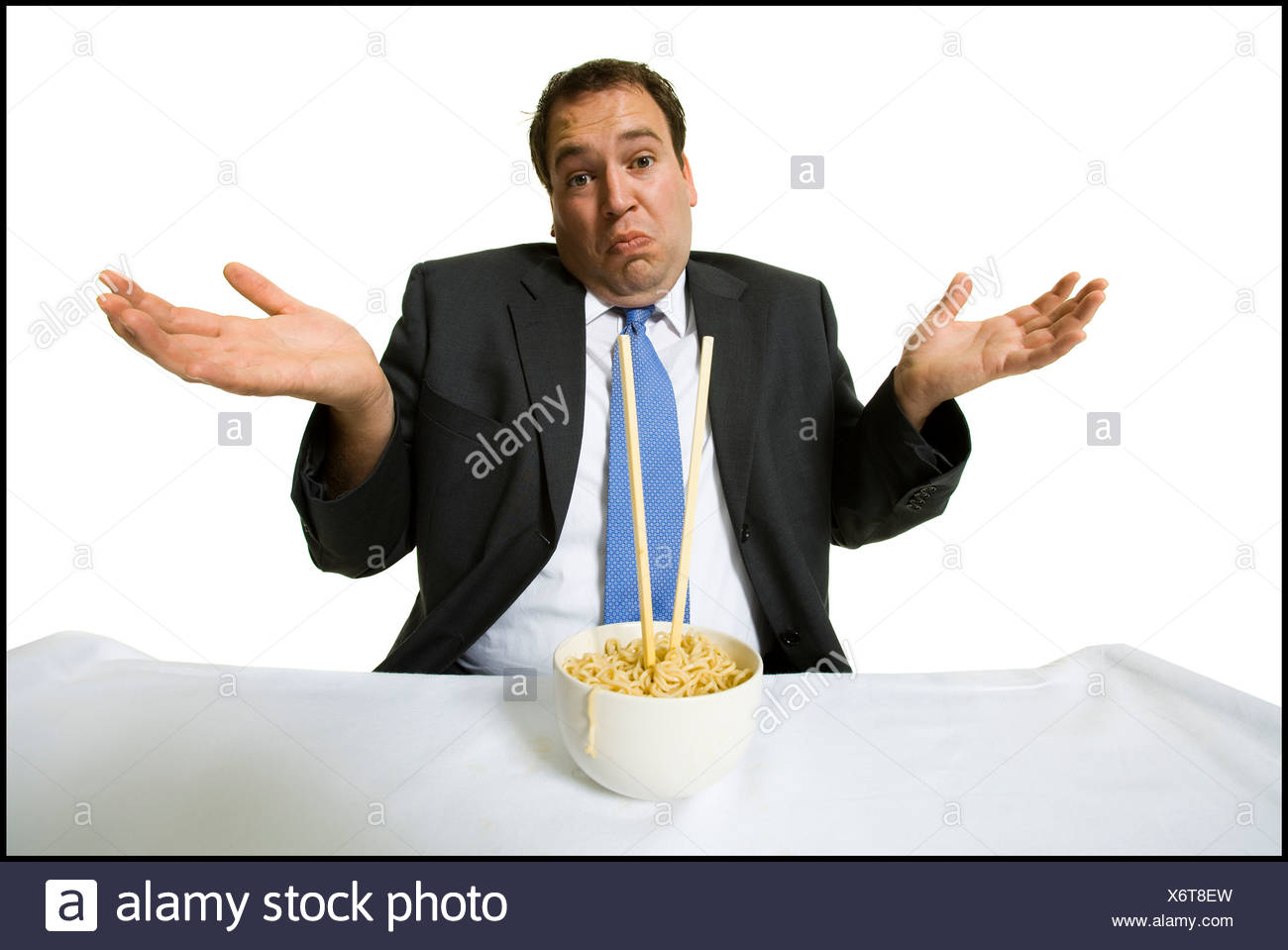 Businessmen eating noodles Stock Photo