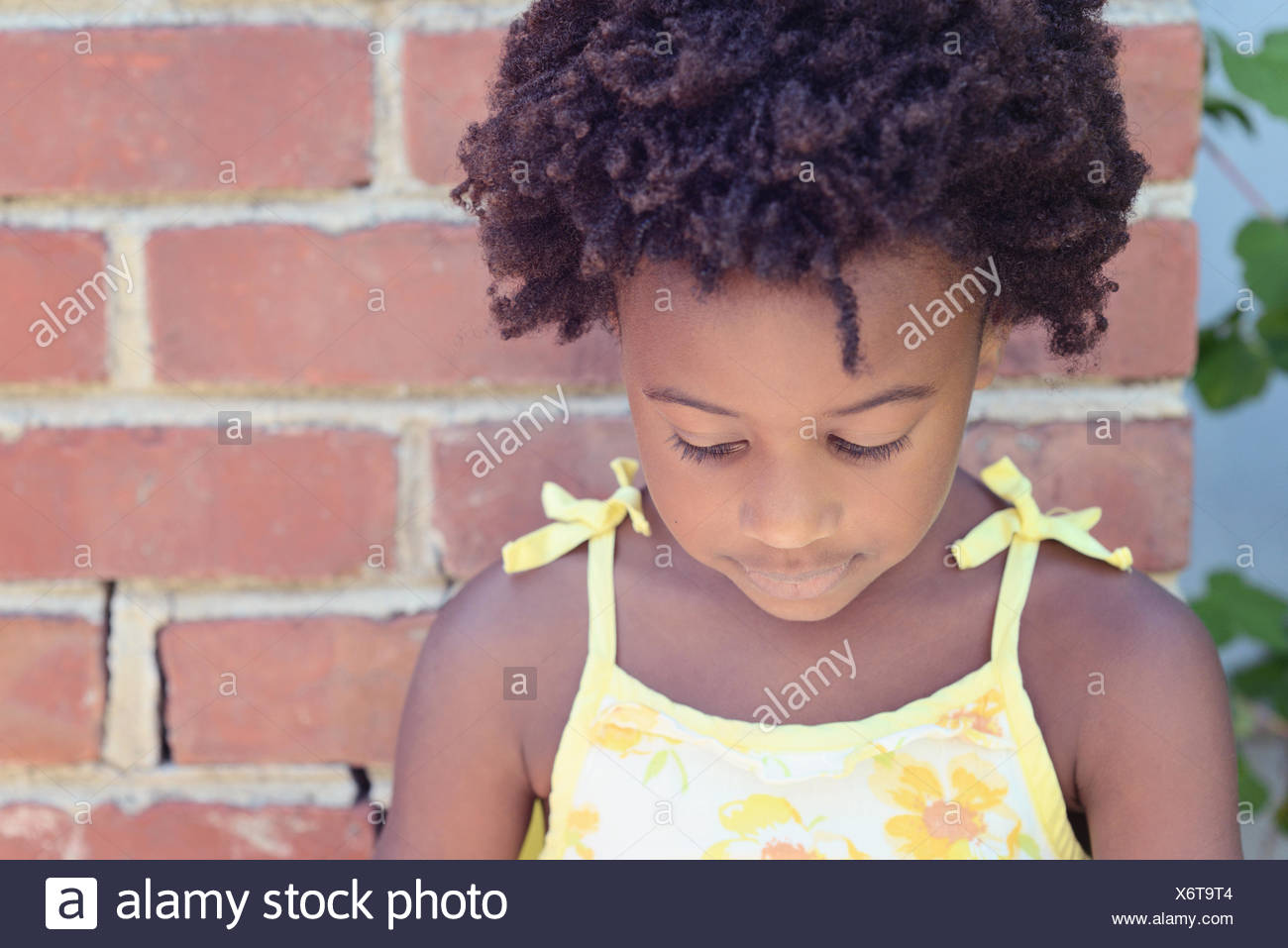Portrait of an african american girl looking down - Stock Image
