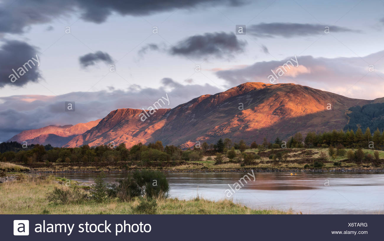 Mam na Gualain and Beinn na Caillich, two of the mountains on the north bank of Loch Leven, in evening light, Loch Leven - Stock Image