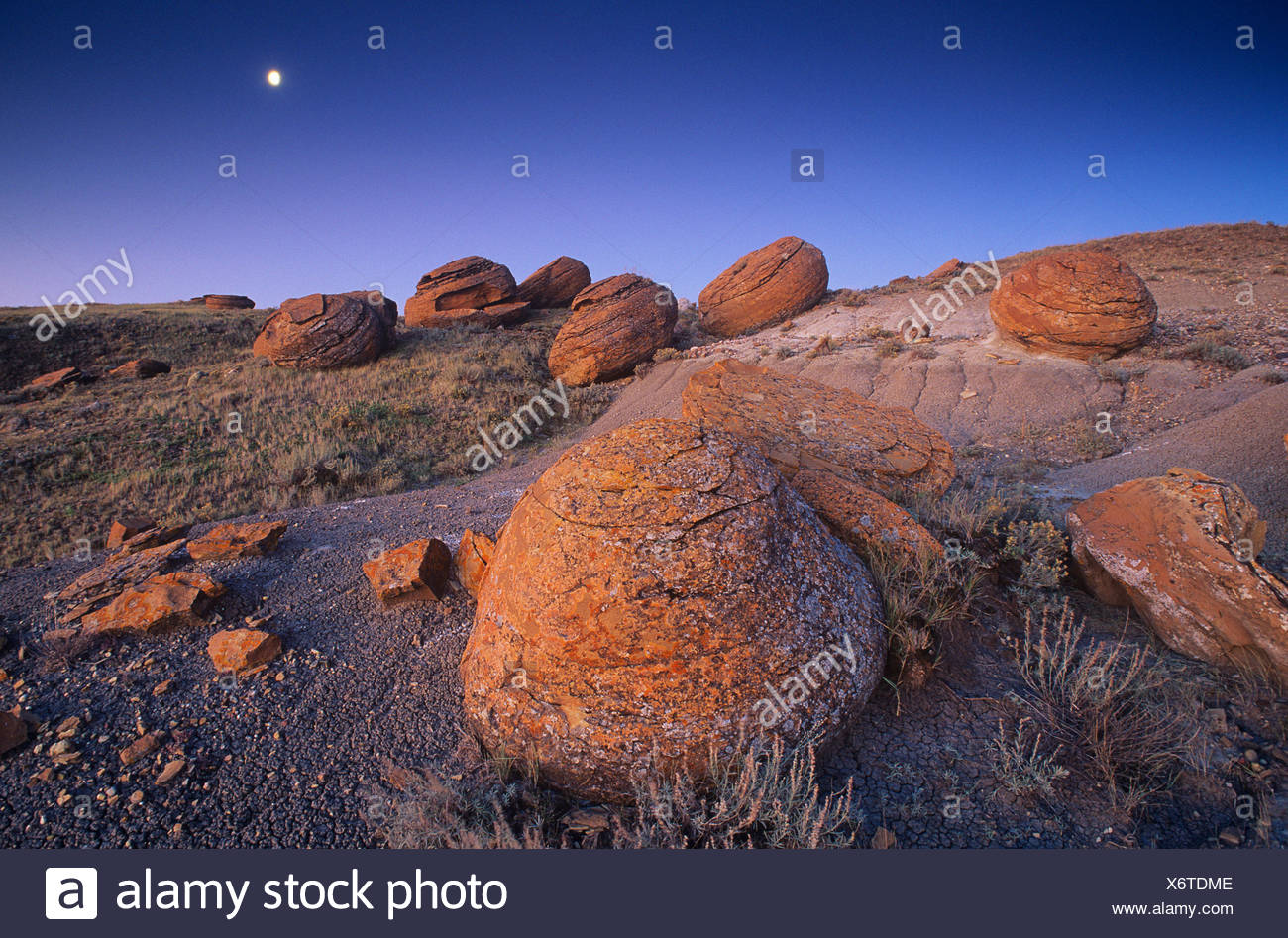 Moonrise in Red Rock Coulee. Alberta, Canada. - Stock Image