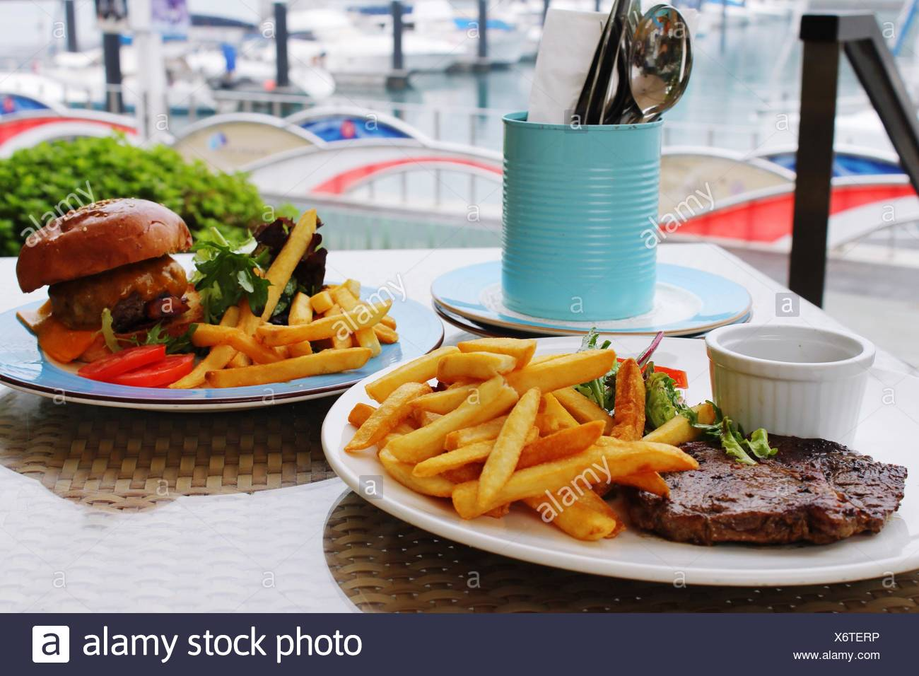 Close-Up Of Fries With Burger - Stock Image