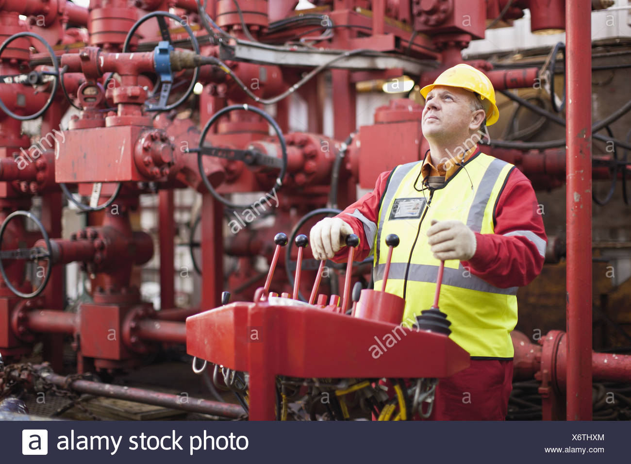 Worker operating machinery on oil rig Stock Photo: 279594748 - Alamy