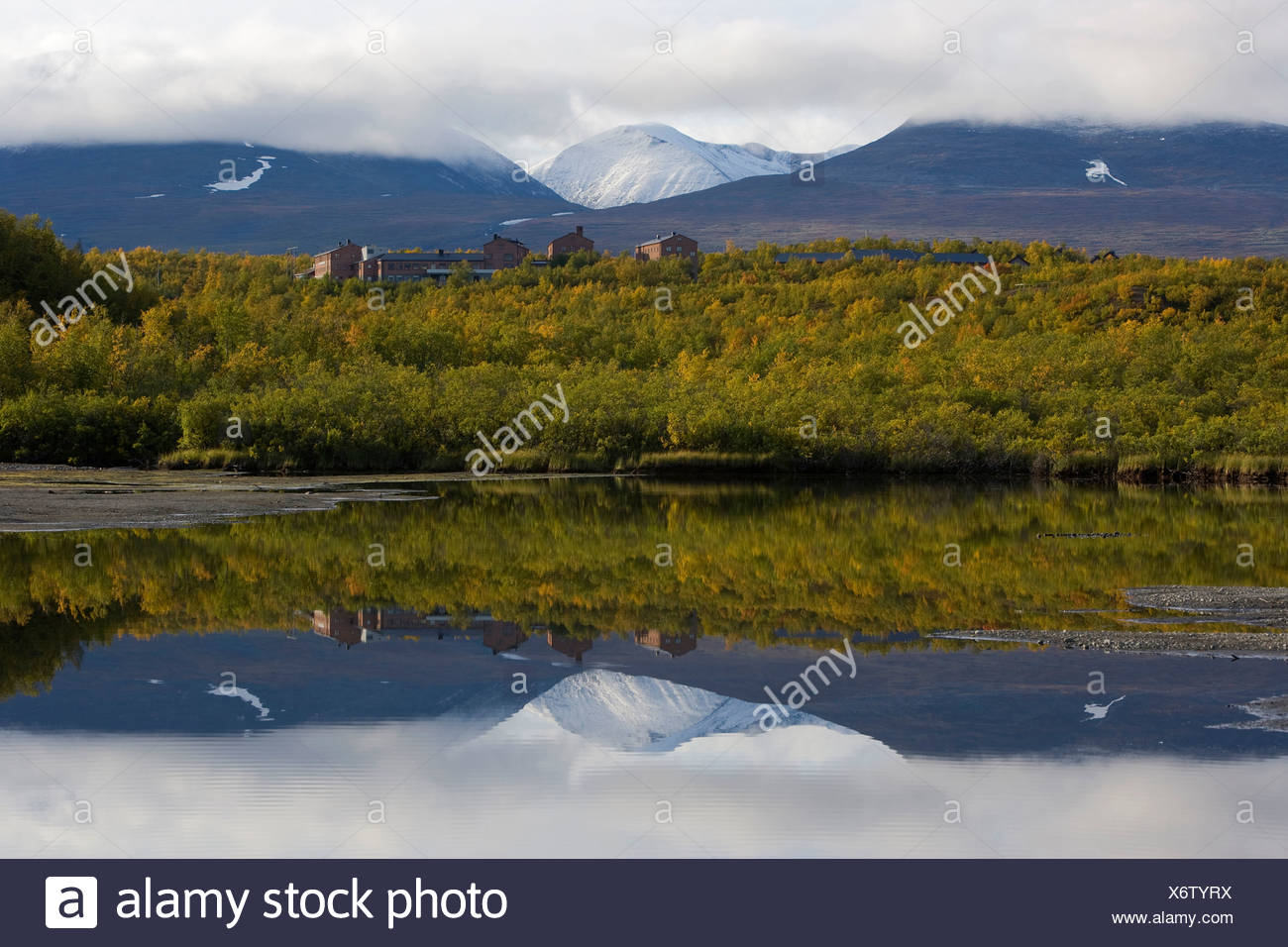 Reflection of the mountain and landscape in the peaceful lake at Lapland, Sweden - Stock Image