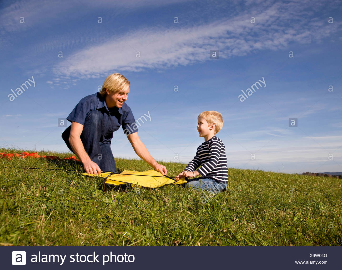 Boy and father put together a Kite Stock Photo