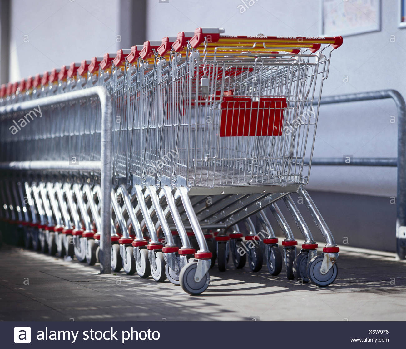 Supermarket, shopping cart, series, detail, shopping, basket goods, baskets goods, carriages, shopping baskets, one after the other, into each other, system, conception, order, ordered, purchasing, retail trade, outside - Stock Image