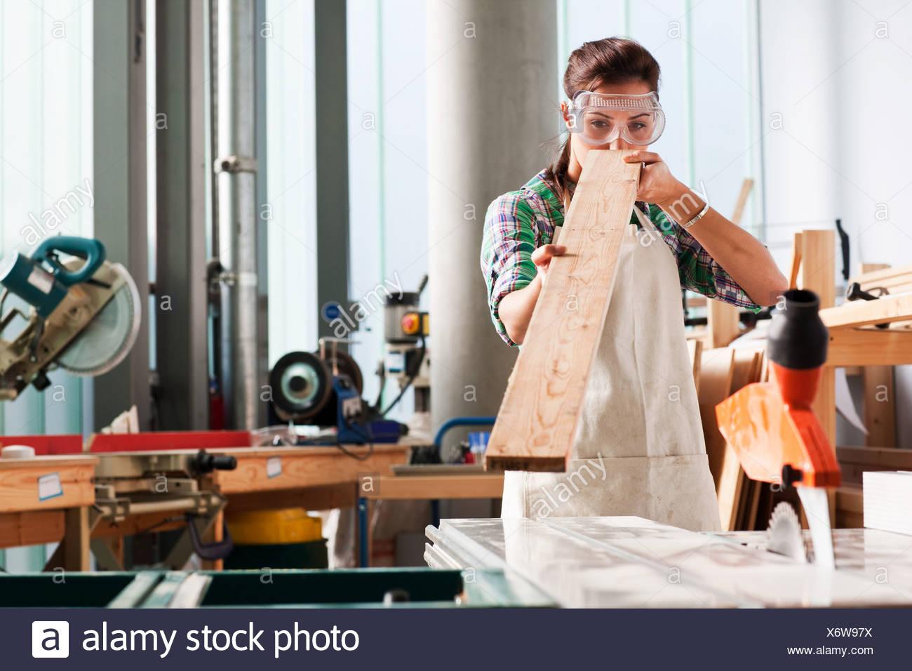 Carpenter checking angle wood workshop - Stock Image
