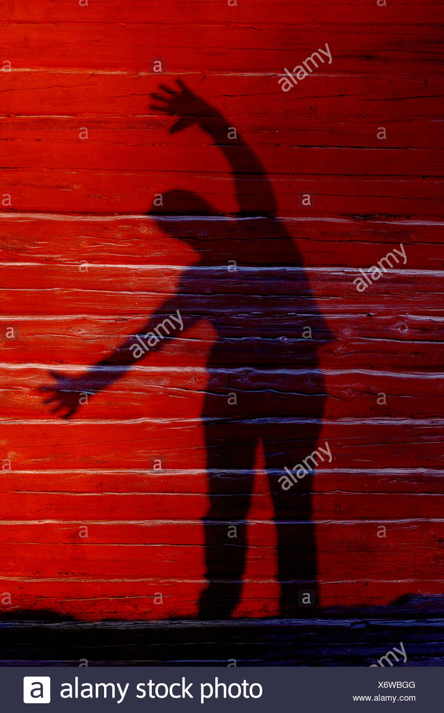 A shadowy figure on a timber wall, Sweden. - Stock Image