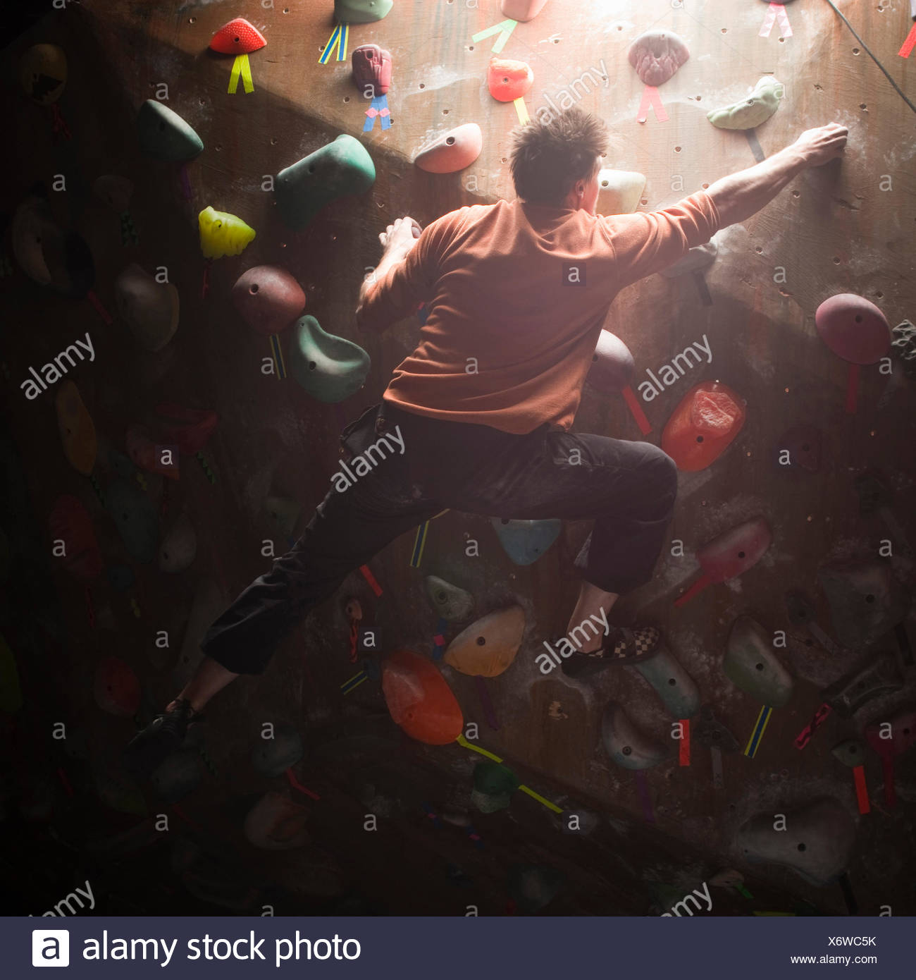 USA, Utah, Sandy, man on indoor climbing wall - Stock Image