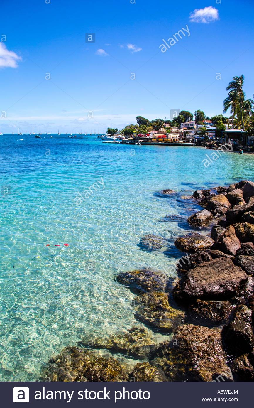 Gorgeous blue sea through transparent water in the South of Martinique. Caribbean Stock Photo