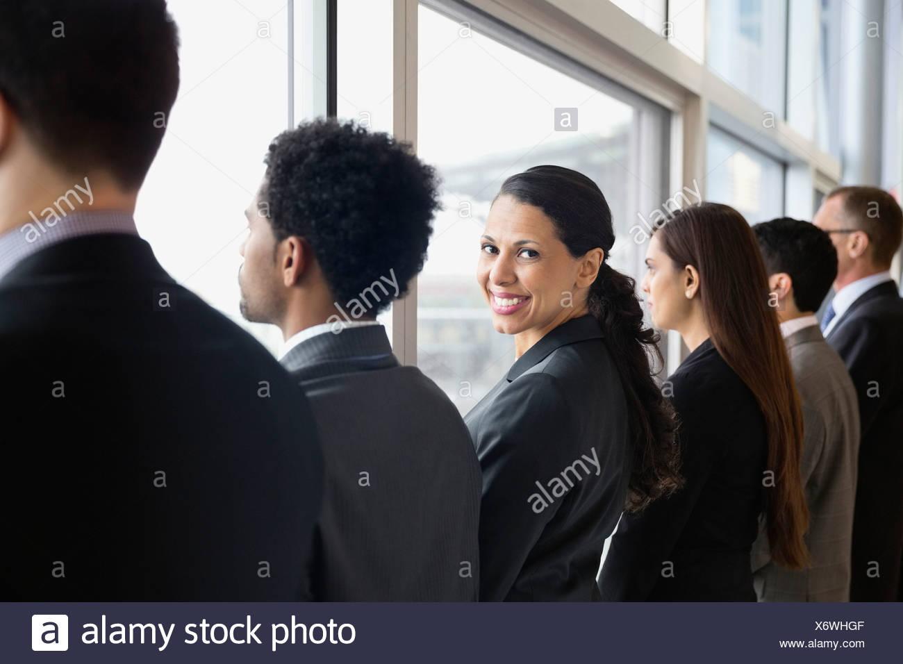 Businesswoman looking over shoulder Stock Photo