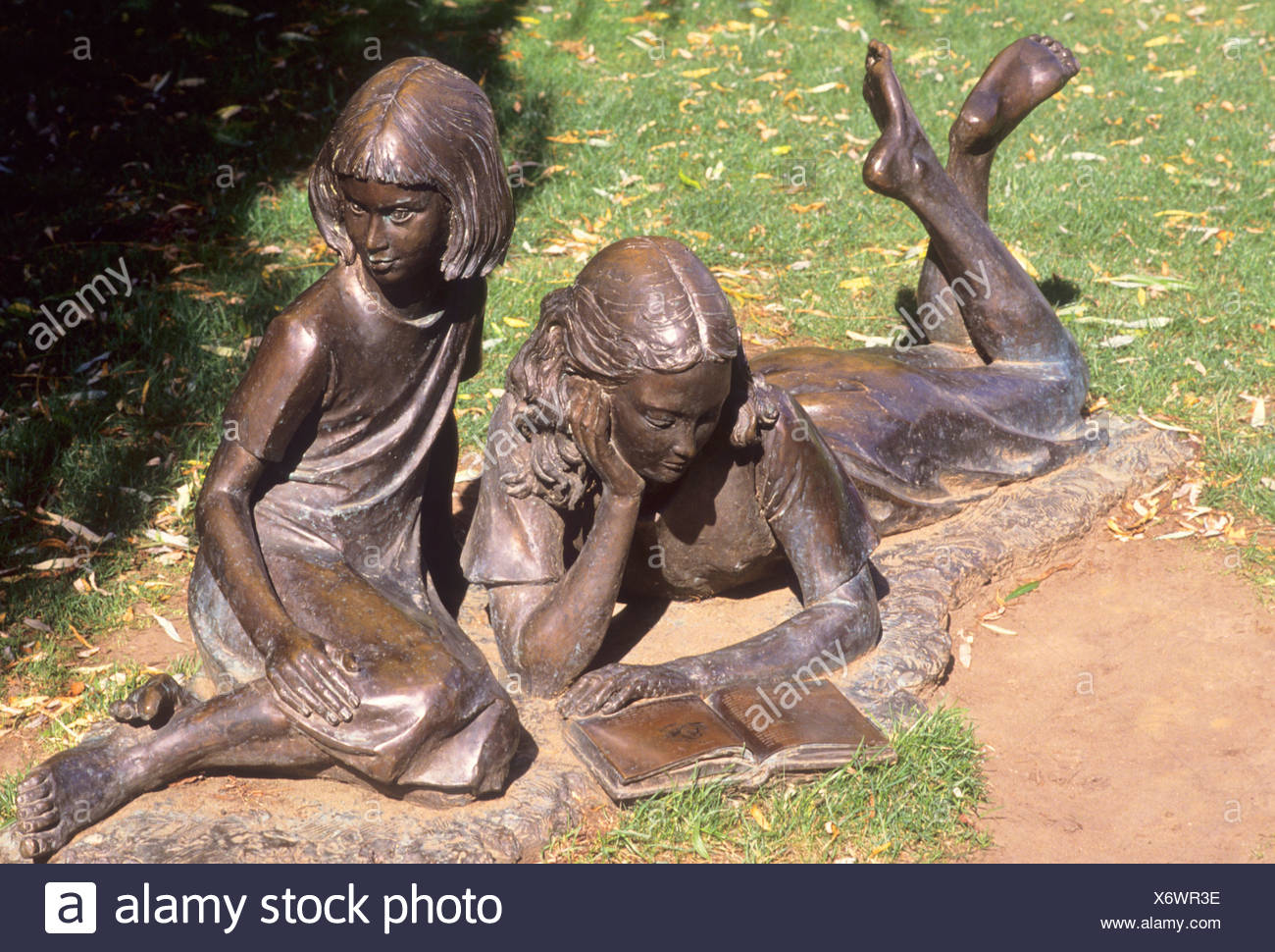 Guildford Alice in Wonderland and sister bronze figures Millmead Lewis Carroll author Edwin Russell sculptor near River Wey - Stock Image