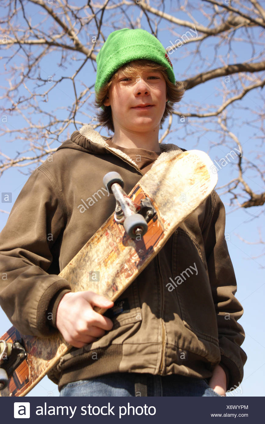 sport sports lifestyle teen male masculine youth hobby spring bouncing bounces hop skipping frisks jumping jump pose outdoor - Stock Image