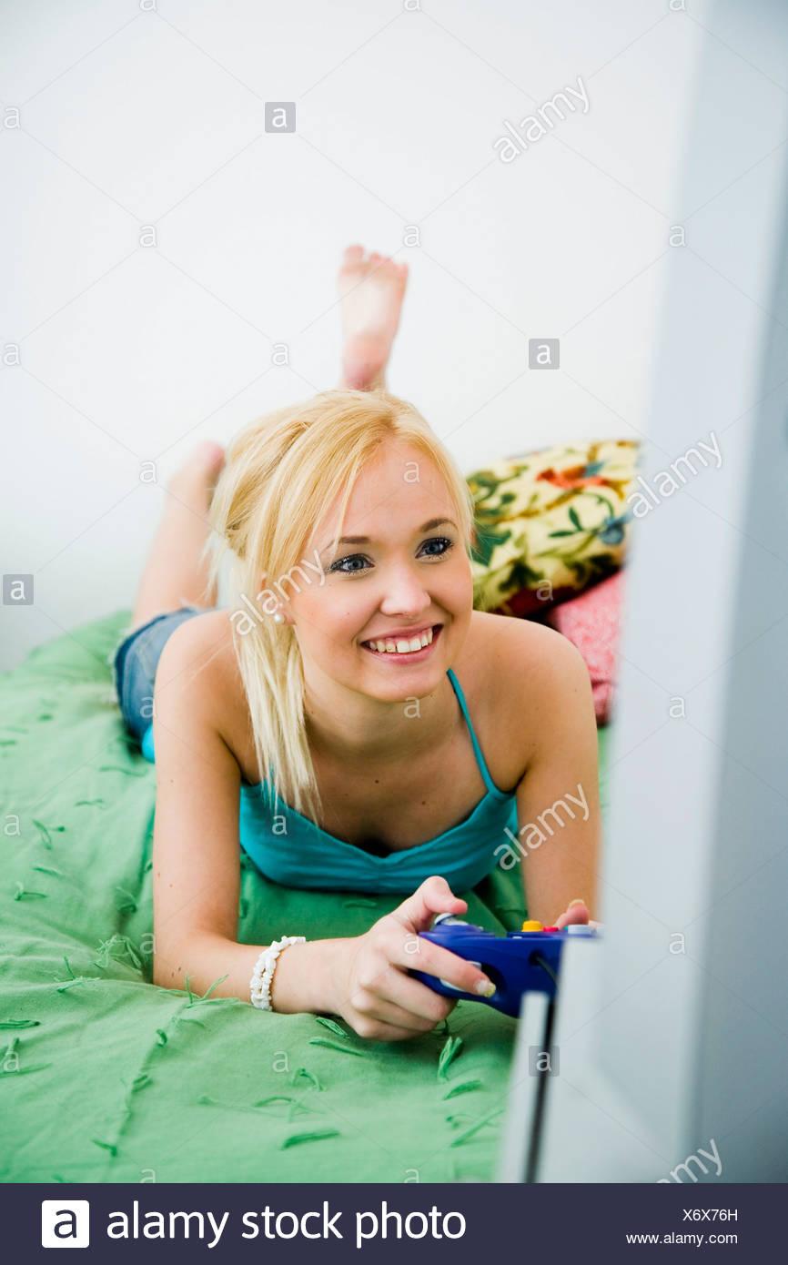 Girl playing videogames - Stock Image
