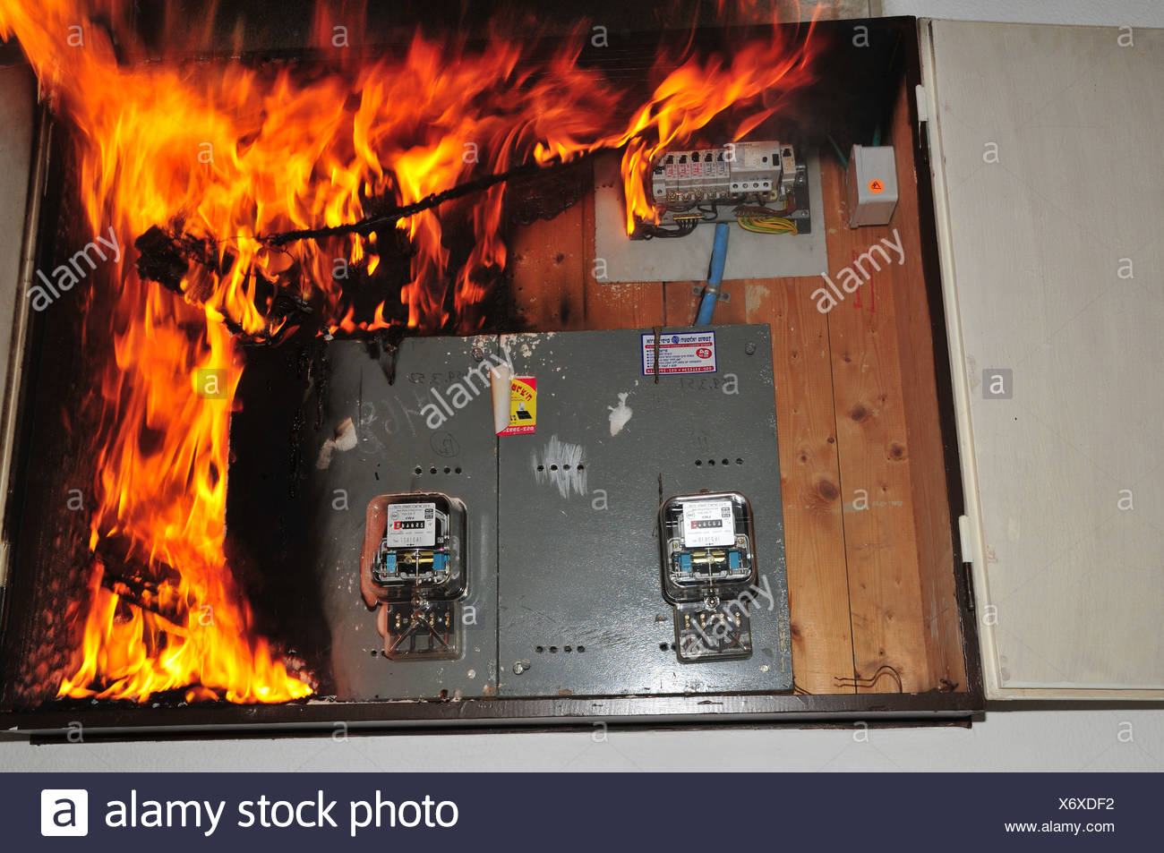 a fire broke out in a household electrical fuse box flames consumed the  board  photographed