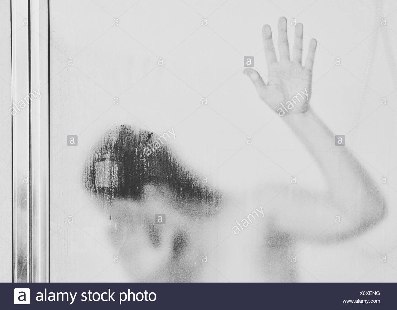 Woman In Bathroom Seen Through - Stock Image
