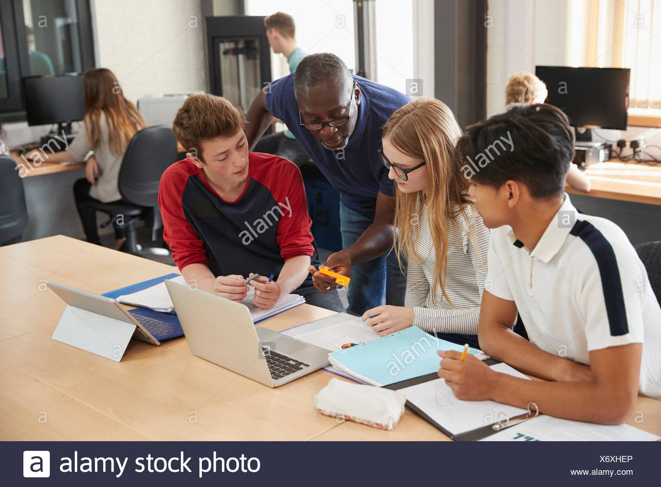 Design Students With Teacher Working In CAD/3D Printing Lab - Stock Image