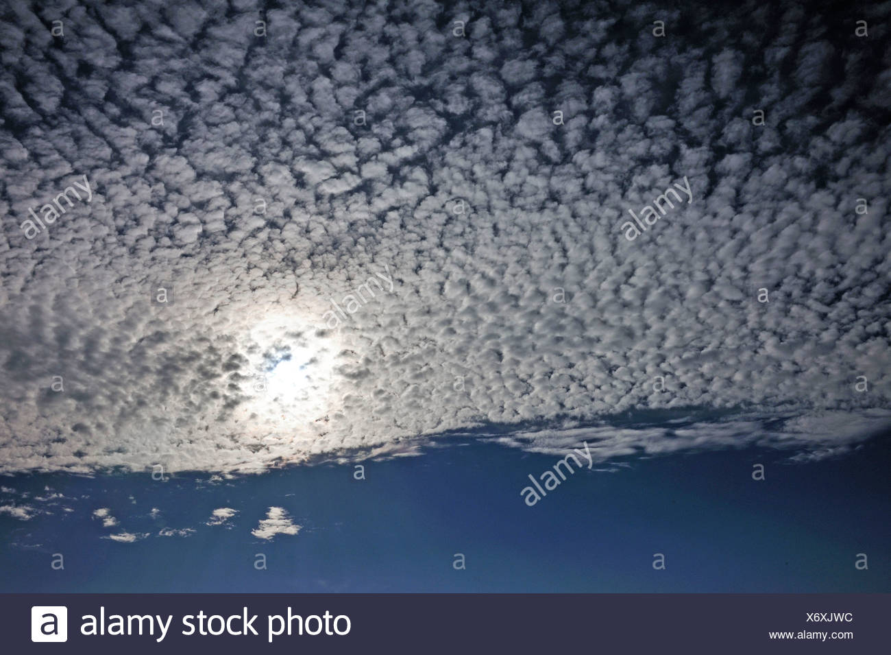 Fluffy clouds or cirrocumulus clouds, with the sun, Bentin, Rögnitz, Mecklenburg-Western Pomerania, Germany - Stock Image